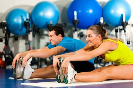 Photo for Exercising doing sit-ups in the gym for better fitness - Royalty Free Image