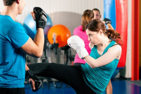 Woman Kick boxer kicking her