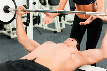 Man in gym with personal