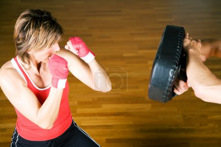 Photo for Trainer supervising the boxing student - Royalty Free Image