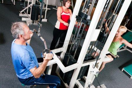 Senior in a gym