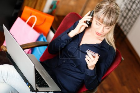 Woman sitting with a laptop in