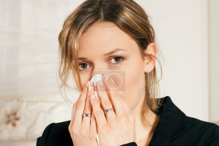 Woman with a flu or cold having