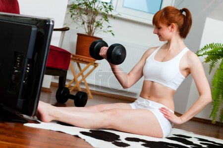 Woman is exercising with