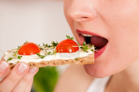 Woman eating healthy in her