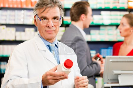 Pharmacist with customers in
