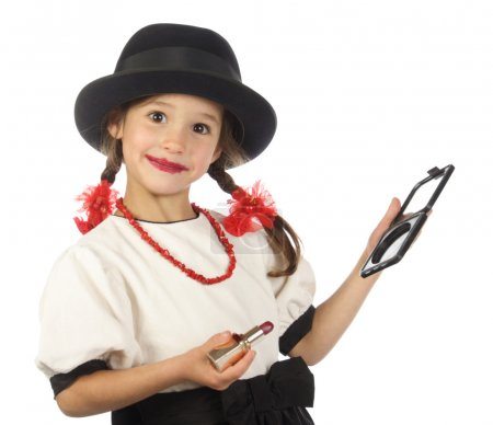 Smiling little girl with red lipstick