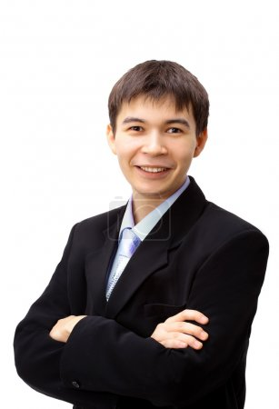 Good looking asian business man standing with arms folded