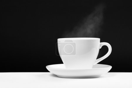Photo for White cup with hot beverage over black background - Royalty Free Image