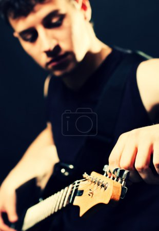 Photo for Musician tune up the guitar at the stage - Royalty Free Image