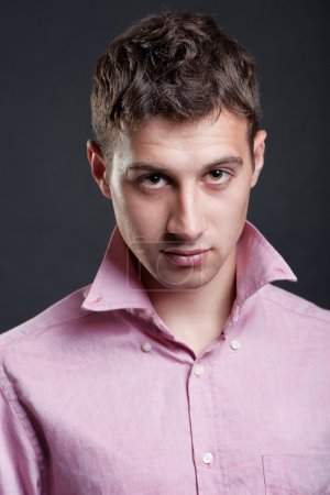 Photo for Portrait of young handsome man in pink shirt - Royalty Free Image
