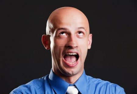 Screaming bald man