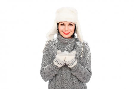 Woman holding snow in mittens