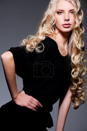 Alluring blonde with long curly hair