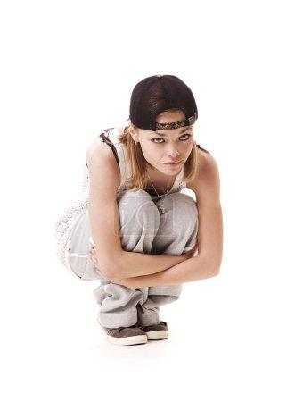 Slim hip hop girl sitting on the floor