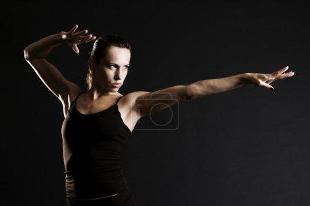 Serious sportswoman in pose