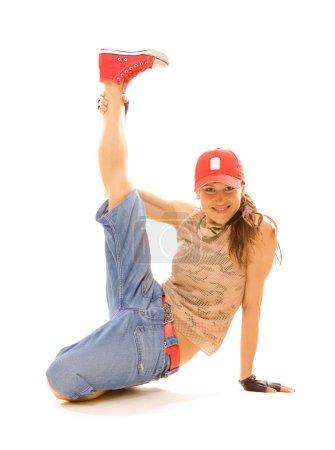 Smiley tomboy holding her leg