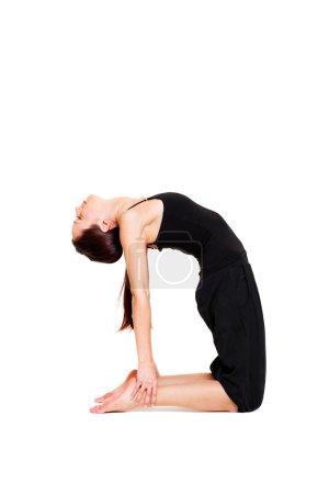 Sporty lively woman in black sportswear flexing