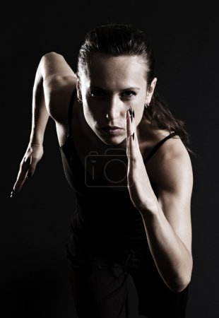 Photo for Woman running over dark background - Royalty Free Image