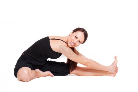 Young woman doing stretch exercise