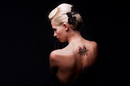 Photo for Portrait of sexy woman with tattoo on her back - Royalty Free Image