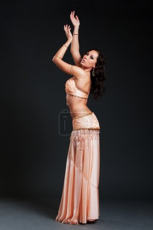 Attractive woman dancing belly dance