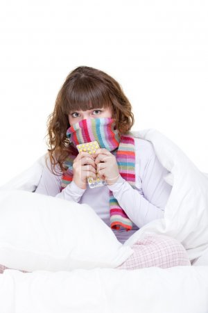Girl in scarf with pills
