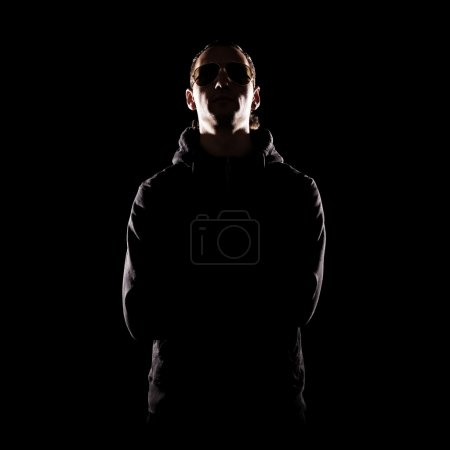 Photo for Stylish portrait of man in sunglasses over dark background - Royalty Free Image