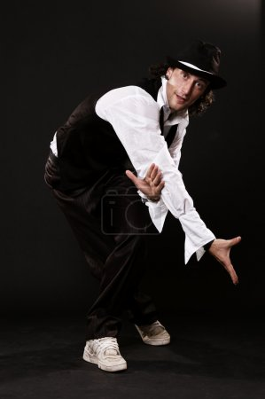 Handsome dancer in stylish wear