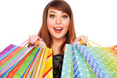 šťastná mladá žena s nákupní tašky