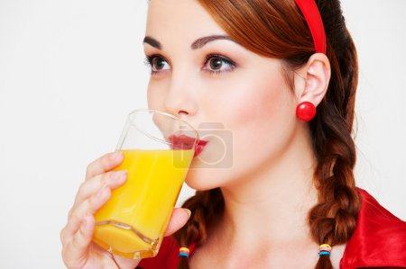 Lovely girl with glass of orange juice