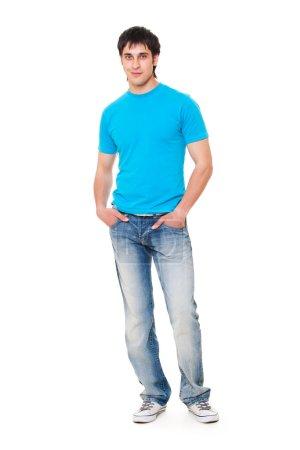 Photo pour Mec souriant en t-shirt bleu et jeans. isolé sur fond blanc - image libre de droit
