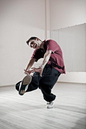 Emotional dancer motioning in dance studio...