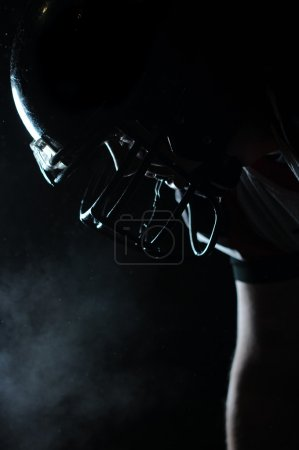 Backlit portrait of american football player