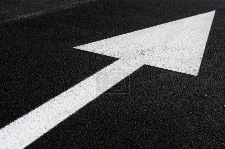 Photo for A white arrow on the road - Royalty Free Image