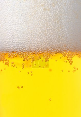 Fresh beer bubbled glass texture