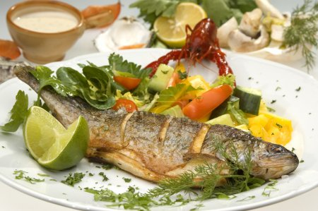 Photo for Grilled trout w limet and vegetable - Royalty Free Image