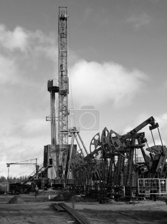 Oil rig in Siberian moor. Black and white photo...
