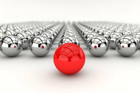 Photo pour Concept de leadership avec sphère rouge et de nombreuses sphères chromées et effet de profondeur de mise au point - image libre de droit