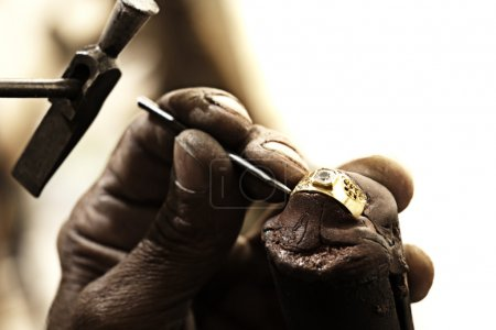 Goldsmith making ring