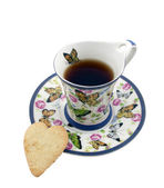 Cup of tea with a cookie in the form of a heart