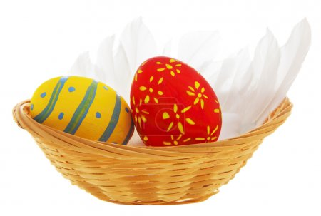 Photo for Easter eggs in the basket isolated on white background - Royalty Free Image
