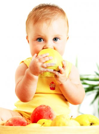 Photo for Little baby eating apple, closeup portrait, concept of health care & healthy child nutrition - Royalty Free Image