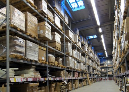 Photo for Warehouse with goods packed at various levels - Royalty Free Image