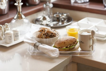 Photo for Sandwiches, orange juice and coffee served for breakfast on a tray - Royalty Free Image