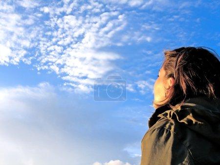 Girl gazing the sky