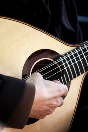 Photo for Detail view of the hand of a guitar musician playing some music. - Royalty Free Image