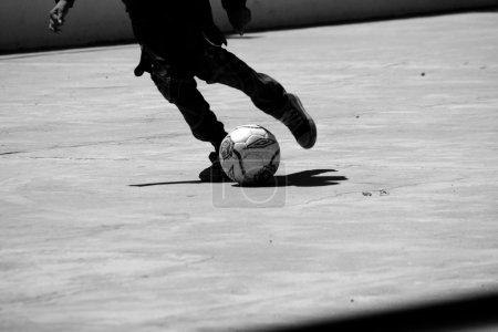 Boy kicks the ball