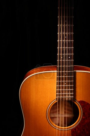 Photo for Acoustic guitar isolated on black - Royalty Free Image