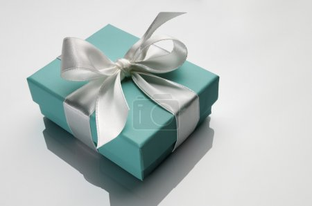 Small turquoise box tied with a white ribbon